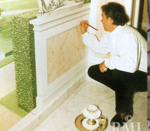 Latzke signing a mural in Ciraghan Palace, using as usual champagne instead of water