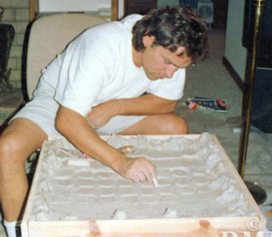 In Malibu Latzke worked on sculptures, here at work on a clay model for bronze chessboard