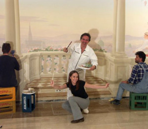 Latzke with assistants in front of the mural in the Lanner-Lehar Hall of the Vienna City Hall