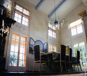 The dining room is painted with illusionistic stone architecture.