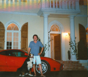 Latzke with dog Enrico in front of the renovated villa
