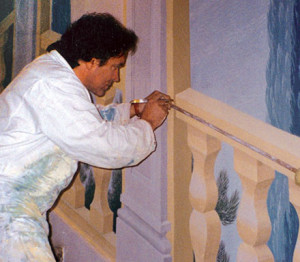 Latzke while painting the staircase