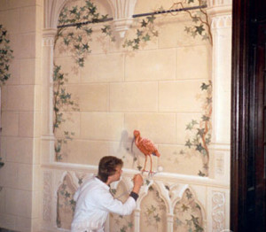 An assistant repairing defects in the painted entrance hall